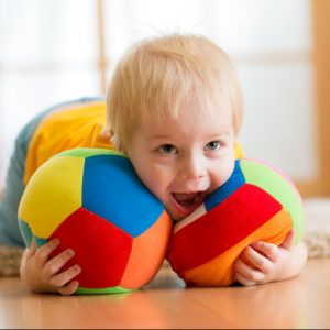 Boy playing with cloth balls